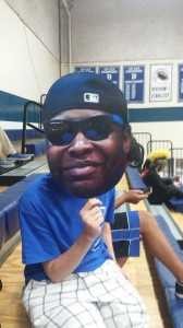 Team 254 member showing his pride with a life-sized EJ face