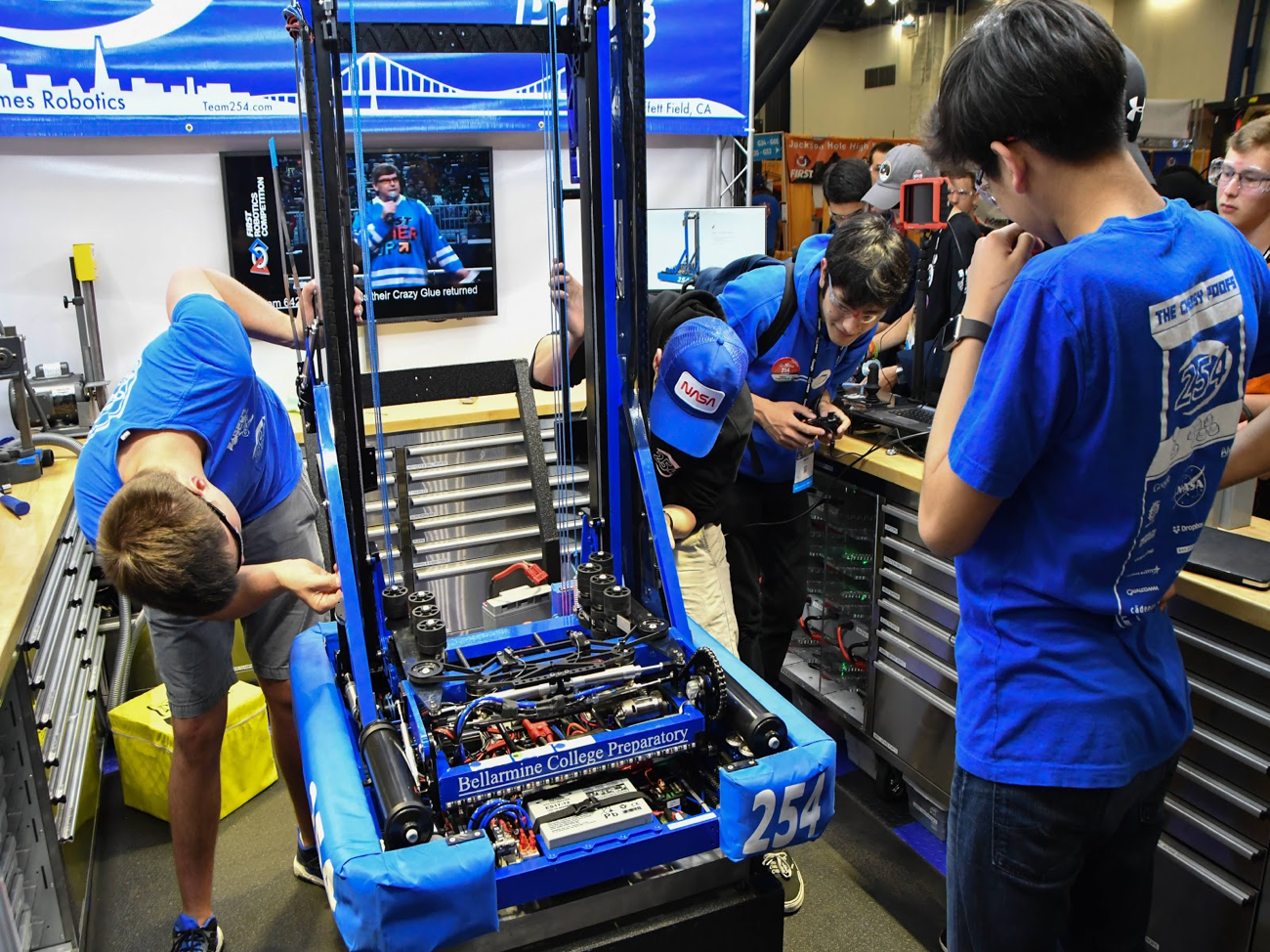 Members of the Team 254 Pit Crew repair Lockdown before an upcoming match
